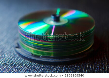 Stack of optical discs and optical drive Stock photo © magraphics