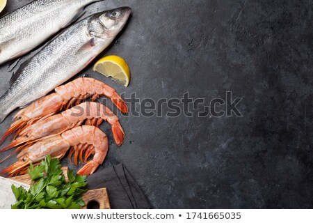 Stock photo: Fresh seafood. Trout fish and langostino shrimps