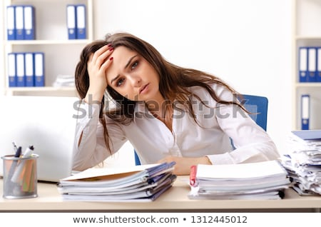 Young female employee unhappy with excessive work  stock photo © Elnur