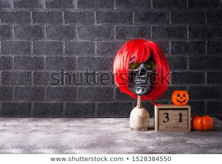 Human skull with red wig Stock photo © furmanphoto