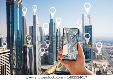 Persona mappa navigazione telefono cellulare schermo Dubai Foto d'archivio © AndreyPopov