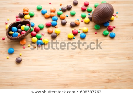 chocolate bunny, eggs and candy drops on plate Stock photo © dolgachov