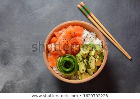 Organic food. Fresh seafood recipe. Fresh salmon poke bowl with  Stock photo © dashapetrenko