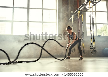 女性 crossfitの アスレチック 若い女性 ロープ 暗い ストックフォト © choreograph