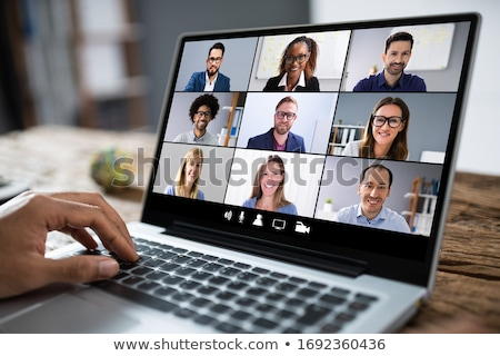 Stock photo: Man Working From Home Having Group Videoconference On Laptop
