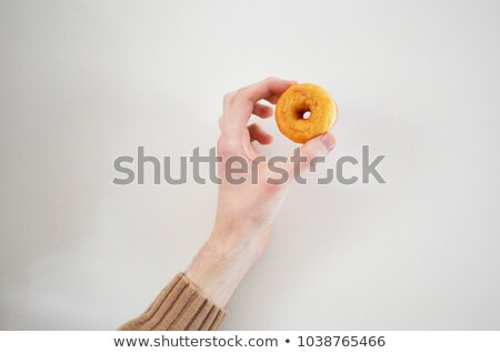 lovely mini donut in mans hand stock photo © ansonstock