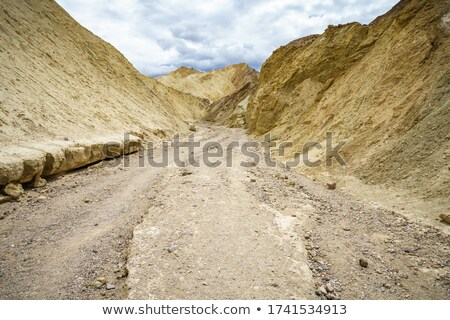beautiful rock trail formations in death valley california stock photo © tobkatrina