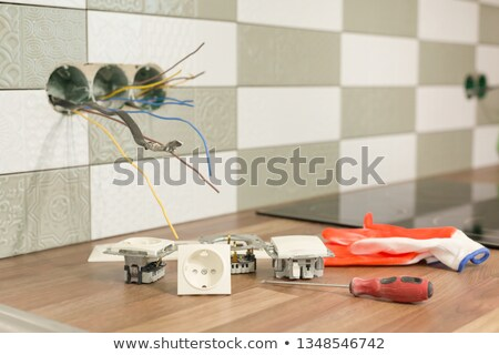 Electrician wiring a wall socket Stock photo © photography33