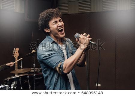 караоке · певицы · человека · пения · лице · фон - Сток-фото © keeweeboy