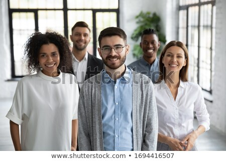 closeup of a young smiling business man standing in three differ stock photo © hasloo