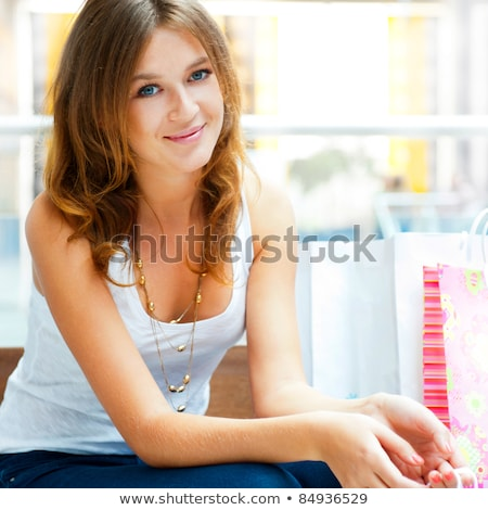 Photo stock: Happy Shopping Woman At The Mall Preparing Gifts For Her Friends