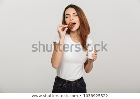 Woman eating a cookie Stock photo © photography33