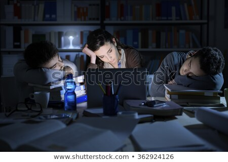 tired student leaning on a pile of books stock photo © photography33