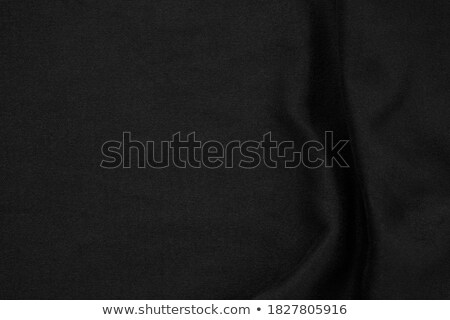 Red fabric drapes on black background, gold vignette stock photo © Ecelop