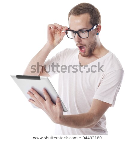 Surprised Nerd Man Looking at Tablet Computer stock photo © adamr