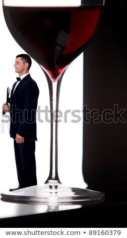 wine steward posing next to giant glass of wine Stock photo © photography33