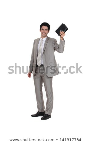 Businessman holding his leather-bound agenda Stock photo © photography33