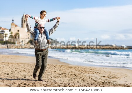 man carrying little boy in his shoulders stock photo © photography33