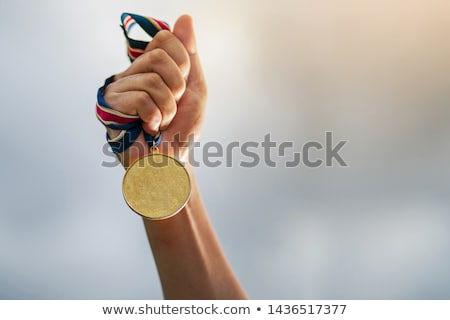Gold medal with ribbons background Stock photo © cienpies