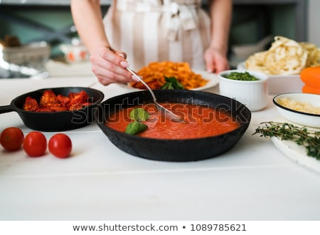 young woman cutting tomato for pasta stock photo © rob_stark