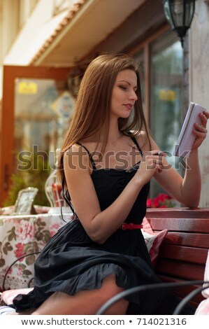 style girl sitting on the bench in the cafe photo in black and stock photo © massonforstock