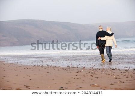 Férfi sétál part nap tengerpart tengerpart Stock fotó © filmstroem