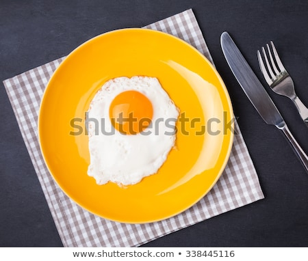 Eggs on a yellow plate Stock photo © anskuw