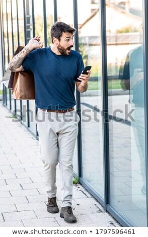 Elegante jonge knappe man naar iets interessant Stockfoto © Victoria_Andreas