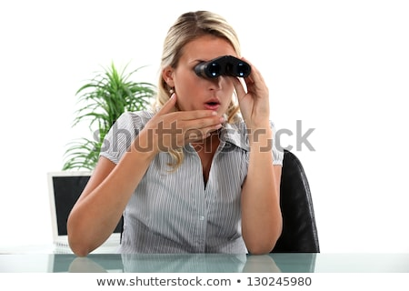 Office worker looking through a pair of binoculars Stock photo © photography33