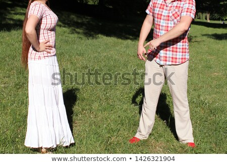 young woman hugging her boyfriend with a look of uncertainty stock photo © photography33