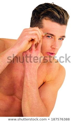 young man tweezing eyebrows Stock photo © ambro