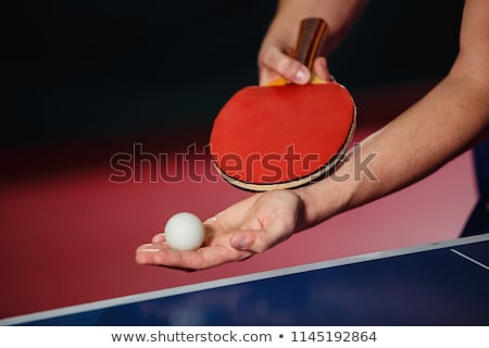 Holding a Ping-Pong Paddle Stock photo © winterling