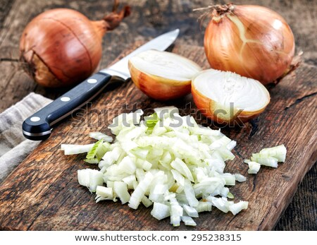 Onions and chopped onion on cutting board with knife. Stock photo © Reaktori