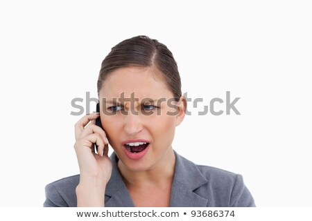 Close up of angry tradeswoman yelling at caller against a white background Stock photo © wavebreak_media
