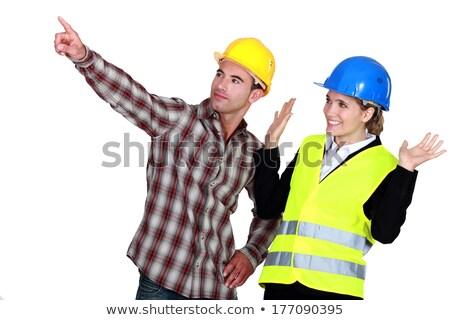 Construction worker pointing out a problem while his co-worker denies any involvement Stock photo © photography33