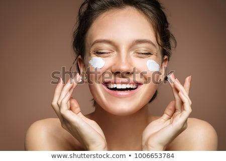 Beautiful young woman face with applying natural beauty make-up Stock photo © meinzahn