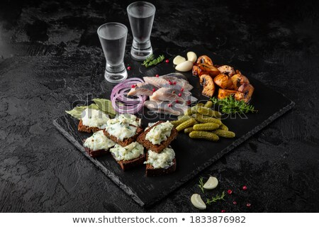 Delicious lamb chops with flames on wooden table stock photo © Kesu