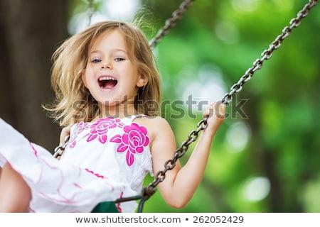 portret · piękna · dziewczyna · huśtawka · jasne - zdjęcia stock © vwalakte