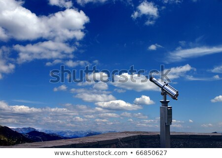 Spyglass pointed to clear blue sky stock photo © gophoto