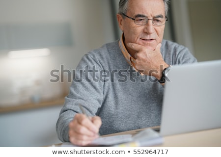 old man with laptop stock photo © barabasa