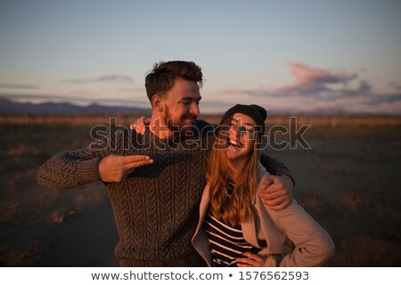 in love couple standing embraced in the dawn and smile Stock photo © feedough