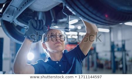 Female mechanic working under the car  Stock photo © sumners