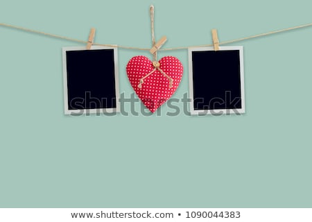 Blank instant photos and red heart hanging on the clothesline Stock photo © karandaev
