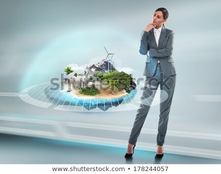 Stock photo: Business woman standing near her better world project