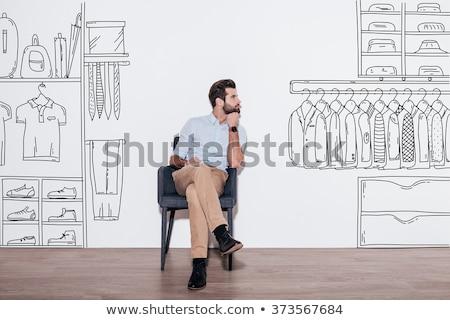 Ruhásszekrény férfi lezser rózsa modell otthon Stock fotó © meinzahn