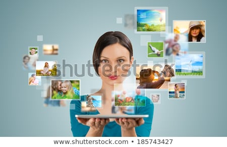 Woman sharing photo social media using tablet computer Stock photo © HASLOO