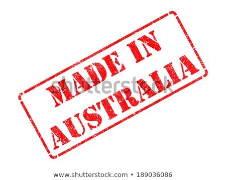 made in australia   inscription on red rubber stamp stock photo © tashatuvango