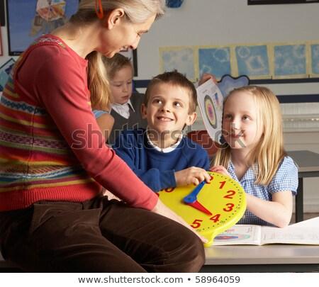 női · általános · iskola · tanár · dolgozik · asztal · osztály - stock fotó © monkey_business