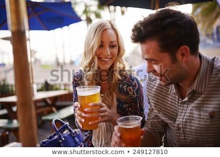 man drinking beer on outdoor patio stock photo © tab62