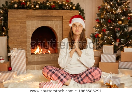 pleased young girl in a christmas santa hat stock photo © stryjek
